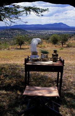 KEN1297 Cottar's 1920 Safaris. Camp writing table overlooking the Masai Mara