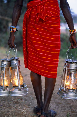 KEN1301 Service in the bush - kerosene lanterns light the pathway to your tent on a Cheli & Peacock mobile safari.  - Not to be sold to safari operators