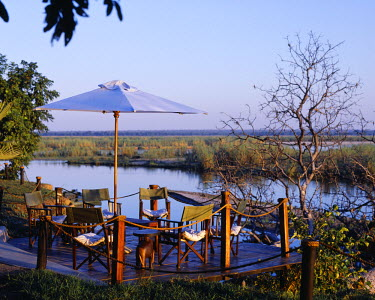 ZAM1887 Zambia, Lower Zambezi National Park, Sausage Tree Camp. Deck looking out towards the Zambezi River.