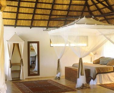 ZAM3455 Bedroom of Honeymoon suite, Kapani Lodge.
