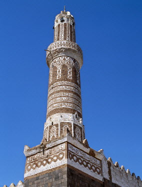 YEM0187 This finely decorated brick minaret is a part of Shibam's most impressive mosque.  Shibam is an ancient town in the governorate of Al-Mahwit. It was built at the foot of the Tabal Kawkaban, a large fl...