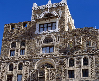 YEM0186 Thilla is a rare example of a well-preserved Yemeni highland town of local stone houses and paved streets surrounded by a massive stone perimeter wall.  Sited at the foot of a high mountain, the inhab...
