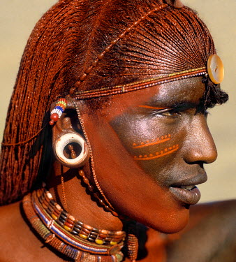 KEN4047 A Samburu warrior resplendent with long, braided, Ochred hair.  The round ear ornaments of the warriors are fashioned from ivory.  Samburu warriors are vain and proud, taking great trouble over their...