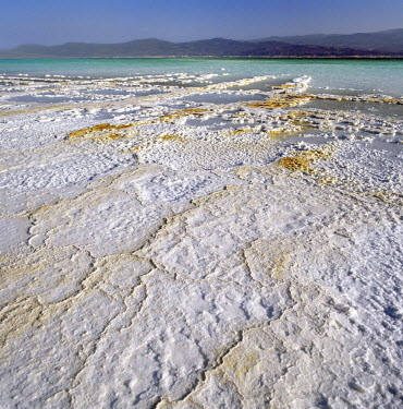 DJI1013 Pure salt crystallizes on the flats beside Lake Assal.  At 509 feet below sea level, Lake Assal is the lowest place in Africa. From time immemorial, nomadic Afar tribesmen have come here with their ca...