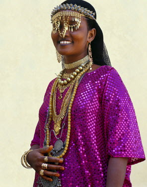 DJI1034 An Afar girl from the Sultanate of Tadjoura wears exotic gold jewellery for marriage and other important celebrations. Although some of this jewellery will be made locally, other pieces will have been...