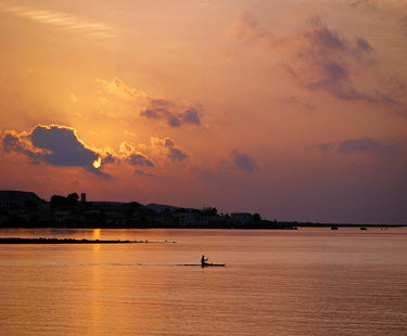 DJI1032 A fishermen paddles his small boat across Tadjoura Bay at sunrise.