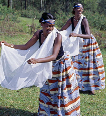 RW1069 Intore dancers perform at Butare.  In the days of the monarchy in Rwanda, Intore dancers performed at the Royal Court. Today, several groups perform nationally and internationally. Their rhythm, movem...