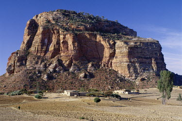 ETH1065 Close to Degum, the rock-hewn church of Debretsion stands on top of a massif, which forms part of the spectacular Gheralta Mountains of Northern Ethiopia. A Tigray homestead stands on the arid Hawzien...