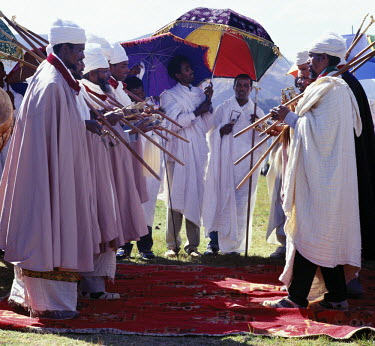 ETH1055 Ethiopian Orthodox priests perform the Dance of the Priests to celebrate Timkat (Epiphany), the church's most important Holy Day.  Ethiopia is Africa's oldest Christian nation where more than half the...