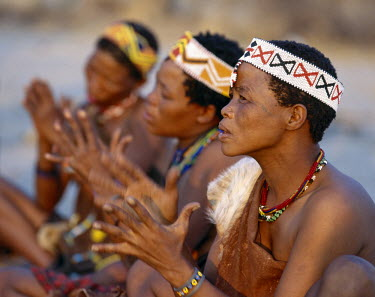 NAM3030 !Kung women sing and clap their hands to the rhythm of their menfolk. The !Kung are San hunter-gatherers, often referred to as Bushmen. They differ in appearance from the rest of black Africa having y...