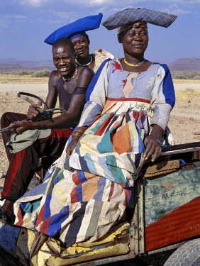 NAM3053 An Herero man and two women ride home in a donkey cart.  The elaborate dresses and unique hat styles of Herero women can be traced back to 19th century German missionaries who took exception to what t...