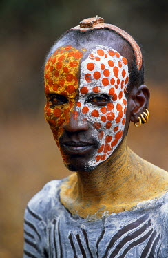 ETH1337 An elder of the Karo tribe, a small Omotic tribe related to the Hamar, who live along the banks of the Omo River in southwestern Ethiopia.  The Karo are renowned for their elaborate body painting usin...