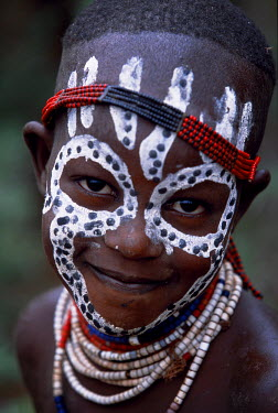 ETH1383 A young Karo girl shows off her attractive make up.  A small Omotic tribe related to the Hamar, who live along the banks of the Omo River in southwestern Ethiopia, the Karo are renowned for their elab...