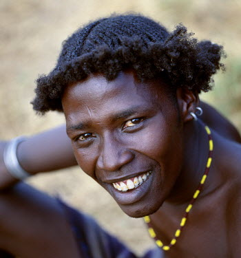 ETH1990 An unusual braided hairstyle of a Dassanech young man of the Omo River Delta. The Omo Delta of southwest Ethiopia is one of the least accessible and least developed parts of East Africa. As such, the...