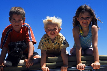 NAM3389 Children on the roof of land cruiser sightseeing in Namibia. (MR)