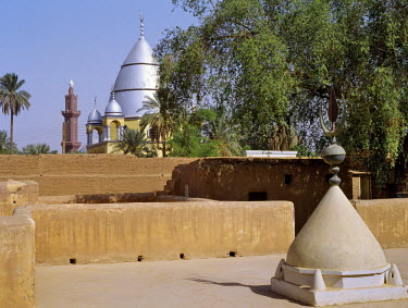 SUD1009 The grave of al-Mahdi lies beneath the large Mausoleum in the background of this picture; the compound of his former home is in the foreground. Domed tombs are customarily built over the remains of ve...