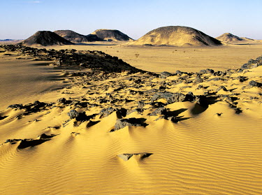 SUD1142 The magnificent desert scenery in the far southwest of the Bayuda Desert has been created by the erosion of sedimentary rock, which in places is highly oxidised. This desert is an extension of the gr...