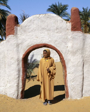 SUD1138 A girl stands outside the decorated archway to a house and compound at Old Dongola.