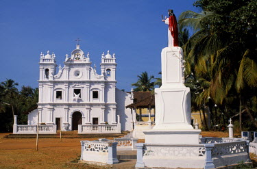 IND5059 The picturesque whitewashed church at the village of Cavelossim.  Whitewashed churches are one of the symbol's of Goa and a legacy of the Portuguese.