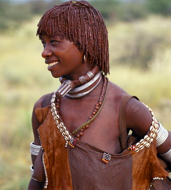 A Hamar woman of Southwest Ethiopia. The phallic protrusion of her necklace denotes that she is her husband's first wife.The Hamar are semi-nomadic pastoralists whose richly-ochred women have striki...