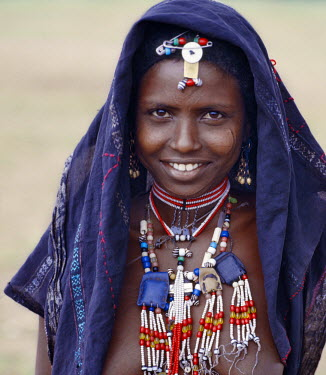 An Afar girl has tribal scarification on her cheeks. Scarification is practiced in only a few sections of her tribe. Proud and fiercely independent, the nomadic Afar people live in the low-lying deser...