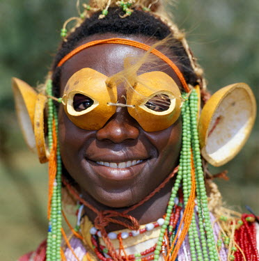 KEN5462 An Mtaita musician.  His 'glasses' are made from the tips of calabashes.  His ear ornaments are also made of calabashes or gourds.