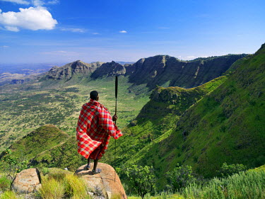 KEN5458 A Samburu warrior gazes at the eastern scarp of Africa's Great Rift Valley at Losiolo, north of Maralal.  From 8,000 feet the land tumbles away 3,000 feet into rugged country, the domain of nomadic pa...