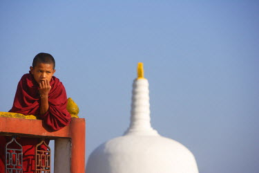 Young Buddhist monk gazing into distance at monastary in Kalimpong, West Bengal, Sikkim.