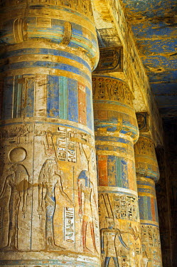 EGY1346 Painted sunken relief carving adorns columns in the mortuary temple of Ramses III on the West bank of the Nile at Luxor.