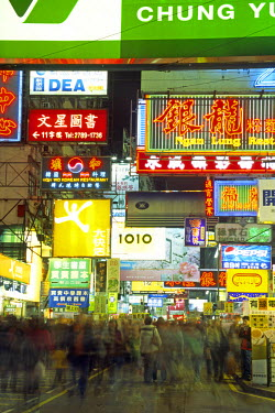 CH1537 Shoppers descend on the neon lit streets of the Yau Ma Tei district in Kowloon, Hong Kong
