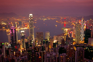 CH1520 View over Hong Kong from Victoria Peak. The illuminated skyline of Central sits below The Peak with the lights of Tsim Sha Tsui in Kowloon across the harbour.