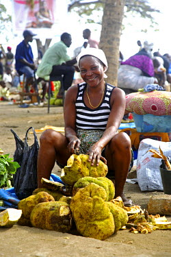 SAO1124 A Sao Tomense lady sells a fruit called Jaca, in the market in the city of Sao Tom�. The fruit was originally from Brazil. It weighs on average between 3-5 kilos. It requires a distinct process to eat...