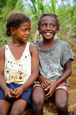 SAO1072 Two young Sao Tomense children. Tom� and Princip� is Africa's second smallest country with a population of 193 000. It consists of two mountainous islands in the Gulf of New Guinea, straddling the equ...