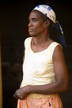 SAO1046 A Sao Tomense woman at the cocoa plant where she works in the small village of Agua Ize in Sao Tome and Principe. Sao Tome and Principe is Africa's second smallest country with a population of 193 000...