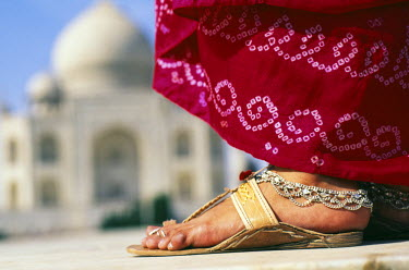 IND5579 Indian foot & sari detail in front of the Taj Mahal, AgraThe Taj Mahal was built by a Muslim, Emperor Shah Jahan (died 1666 C.E.) in the memory of his dear wife and queen Mumtaz Mahal. It is an elegy...