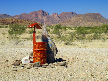 NAM3693 Rooi Drom features on most Namibian maps and a visitor could be excused if he or she expected it to be an important centre. As it name implies, it is a 'Red Drum' set in mountainous desert scenery and...
