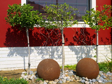 NAM3640 Interesting exterior garden decoration of a fine old building in Swakopmund, an important seaside town on Namibia's windswept Atlantic coast. The place has a distinctly Teutonic flavour, reflecting th...