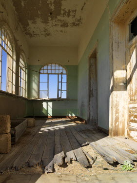 NAM3602 A scene in the deserted diamond-mining town of Kolmanskop, which was abandoned more than fifty years ago.  The place is now a ghost town where sand from the surrounding desert has encroached into all...