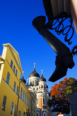 EST1007 An Ornamental Steel Boot hangs infront of the 19th Century Russian Orthodox Alexander Nevsky Cathedral on Toompea Hill, Located in the Unesco World Heritage Old Town