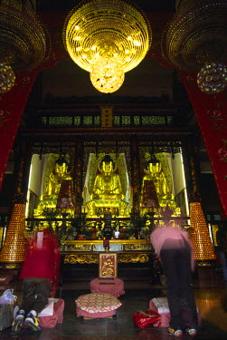 CH1641 Pilgrims kneel at the second temple in the Chuk Lam Sim (Bamboo Forest) Monastery at Tsuen Wan, New Territories. The temple complex is one of the most important in Hong Kong and contains three of the...
