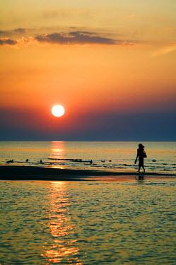 LAT1071 Girl Walking Barefoot on Beach Sunset on the Gulf of Riga