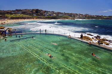AUS0333 Swimmers do laps at the Bronte baths - ocean filled pools flanking the sea at Sydney's Bronte Beach