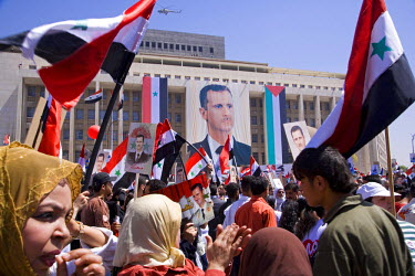 SY1253 Supporters at a rally in downtown Damascus endorsing President Bashar Al-Assad's unopposed election for a second 7 year term of office. May 2007.