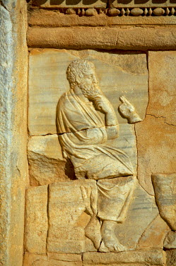 LIB1199 Carving of a philosopher in one of rectangular niches found at the front of the stage in the Theatre at Sabratha, Libya.