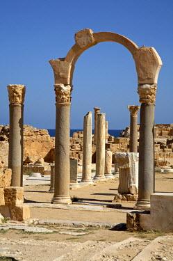 LIB1192 A restored archway marking the entrance to the Curia, or Senate House, at Sabratha, Libya.