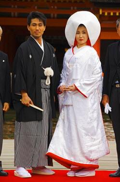 JAP0202 Japan, Honshu Island, Hiroshima Prefecture, Miyajima Island, Itsukushima Shrine. Wedding ceremony family portrait.