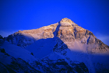 TIB0142 Tibet, Chomolungma, Rongbuk. Mount Everest (8,848m). Sunset on Mount Everest, known locally as Chomolungma. In 1852 the Great Trigonometric Survey of India determined that Mount Everest was definitive...