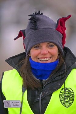 Antarctica, Antarctic Peninsula, Paradise Harbour. Nature guide Gabriela Rodan dons a 'penguin police' vest to ensure that visitors to the breeding colony to do not disturb the young birds or the feed...