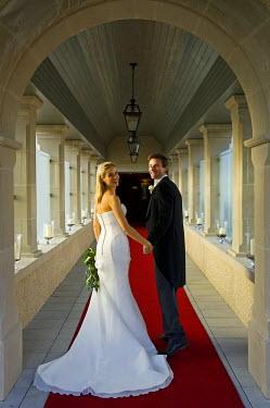 ENG8599 United Kingdom, Northern Ireland, Fermanagh, Enniskillen. Bride and groom arrive at their wedding at the Lough Erne Golf Resort Hotel (MR).