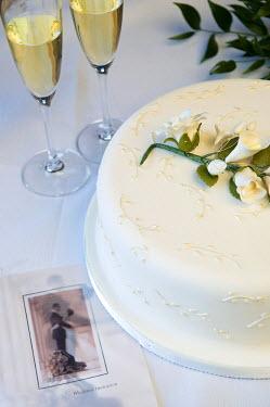 ENG8593 United Kingdom, Northern Ireland, Fermanagh, Enniskillen. Champagne, wedding cake and invitation for a wedding at the Lough Erne Golf Resort Hotel.